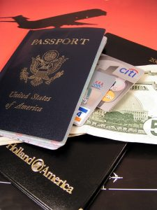 This picture shows a us passport money and credit cards